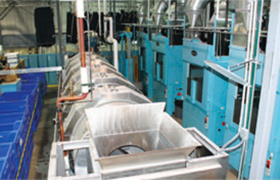 Five Star Laundry adds second tunnel, automates much of plant